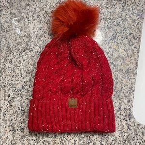 Red beanie with pom